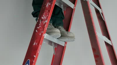 stock-footage-standing-on-ladder-tight